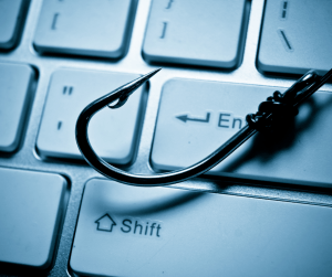hook over keyboard representing spear phishing and whaling, social engineering