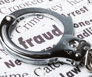 fraud, crime, and other social engineering crime words beneath a pair of handcuffs